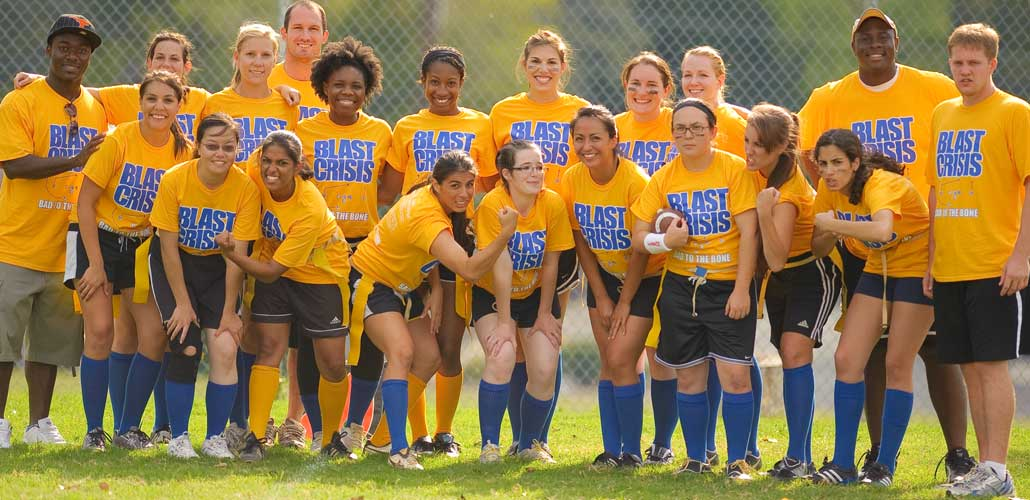 Women's flag football team and coaches displaying united student life.